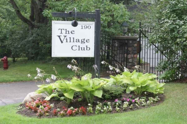 The Village Club Sign